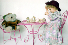 2 years old, having a teaparty with a teddy-bear