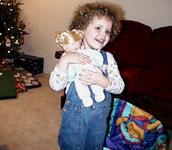 4 1/2 years old, enjoying a Yule present